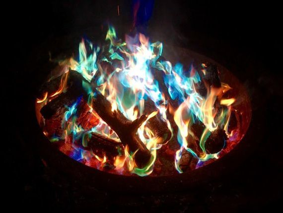 Just Place a Color Changing Fire Log in Your Campfire